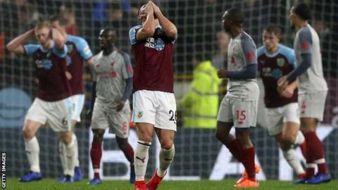 Philip Bardsley of Burnley (centre) reacts after a chance is missed