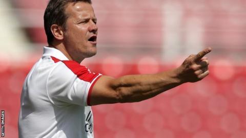 Mark Cooper on the sideline as Swindon boss
