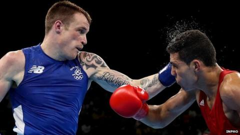 Steven Donnelly lands a punch during his Olympic quarter-final defeat by Mohammed Rabii