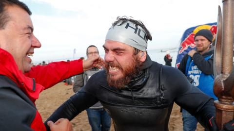 Ross Edgley celebrates after finishing his 'Great British Swim'