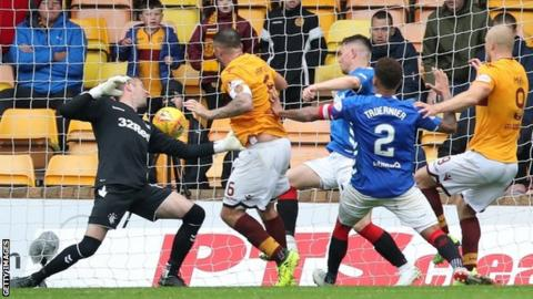 Peter Hartley taps home in injury time for Motherwell to make it 3-3 against Rangers