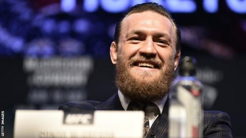 Conor McGregor laughing at the press conference for his fight with Donald Cerrone