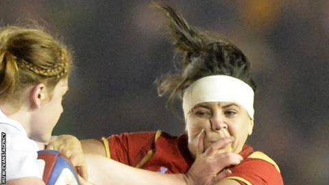 England's Harriet Millar-Mills tackles Sian Williams in the 2016 Six Nations