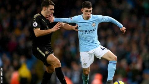 Phil Foden (right) in Premier League action for Man City against Leicester City