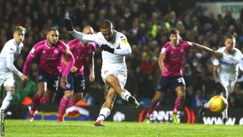 Leeds striker Kemar Roofe scores a penalty against QPR