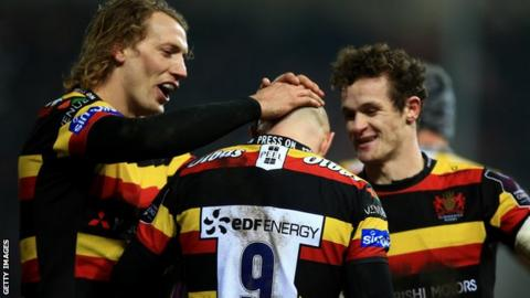 Willi Heinz of Gloucester with Billy Twelvetrees (L) and Billy Burns