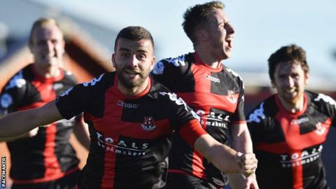Crusaders captain Colin Coates leads the celebrations after Michael Carvill makes it 3-3 against Cliftonville
