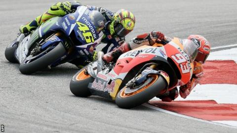 Valentino Rossi (left) battles for position with Marc Marquez
