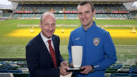 Oran Kearney receives the January manager of the month award from Northern Ireland Football Writers chairman Stephen Watson