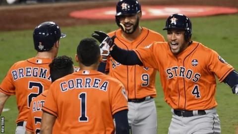George Springer (right) celebrates his home run with Houston Astros team-mates
