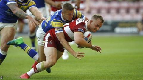 Josh Woods scores a try for Wigan