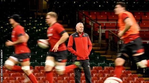Wayne Pivac looks on as Wales players run past him in training