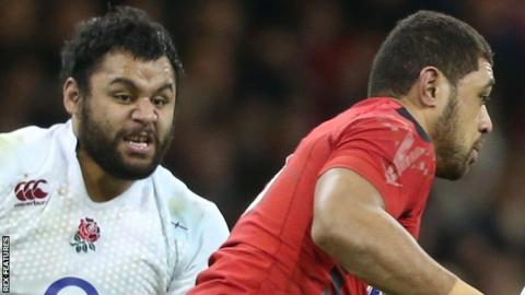 Billy Vunipola chases Taulupe Faletau during the 2015 Six Nations
