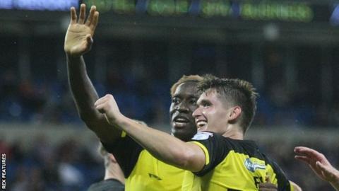 Ben Fox (R) celebrates scoring in Cardiff