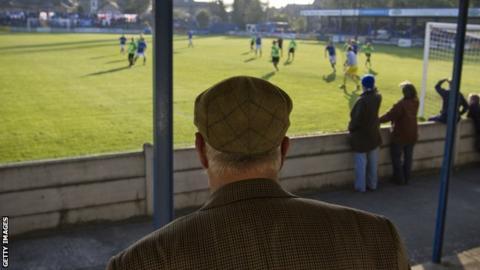 A fan watches a non-league game