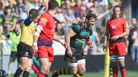 Ben Foden is shown a yellow card by referee Luke Pearce on his final appearance for Northampton