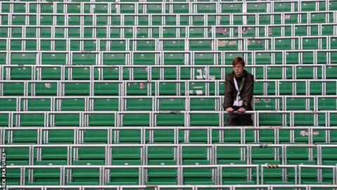 Fan standing in the safe-standing section at Celtic Park