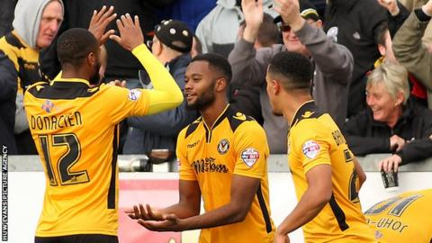 Zak Ansah (centre) celebrates his goal fro Newport