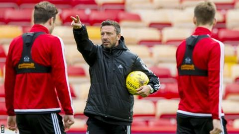 Aberdeen manager Derek McInnes takes training at Pittodrie