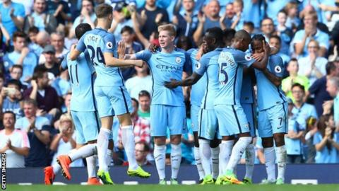 Manchester City players celebrate scoring