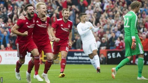 Gary Mackay-Steven celebrates scoring from the spot