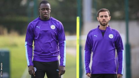 Manchester City players Benjamin Mendy (left) and Bernardo Silva (right)