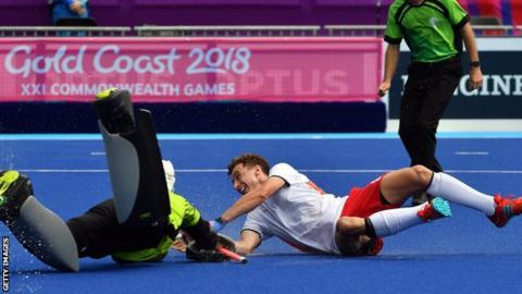 England's Harry Martin scores