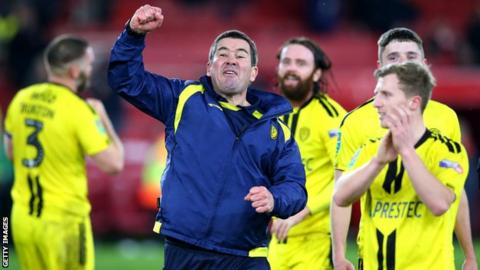Nigel Clough punches the air after Burton Albion reach the semi-finals