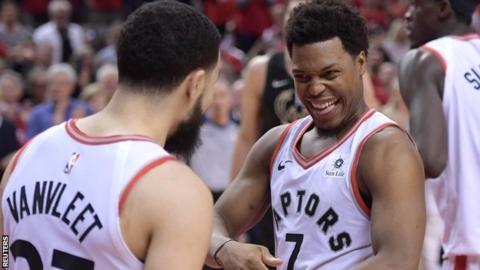 Toronto Raptors guards Kyle Lowry (7) and Fred VanVleet (23) react as the Raptors win