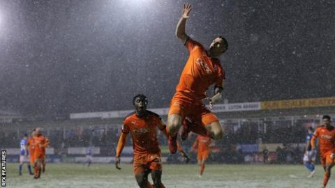 James Collins celebrates a Luton goal