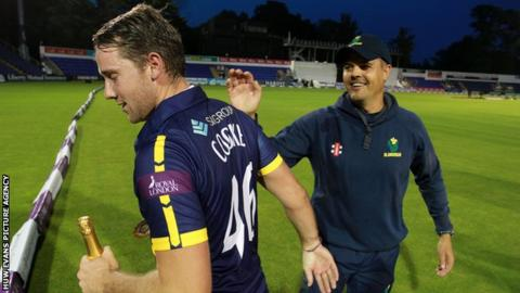 Chris Cooke is congratulated by Glamorgan captain Jacques Rudolph