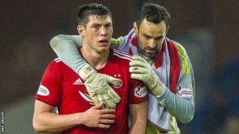 Aberdeen captain Joe Lewis with Scott McKenna