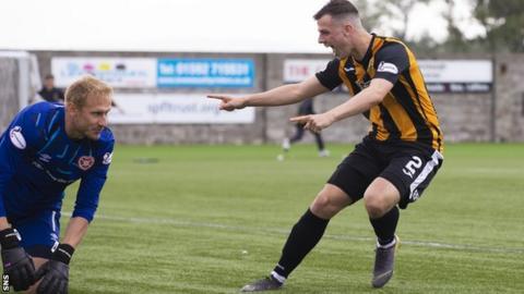 East Fife's Aaron Dunsmore celebrates his winning penalty