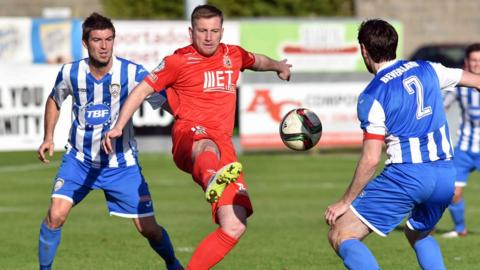Coleraine defenders Steven Douglas and Howard Beverland close in on Portadown striker Mark McAllister at Shamrock Park