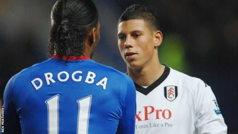 Matthew Briggs (right) shakes hands with Didier Drogba