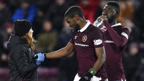 Arnaud Djoum receives treatment on an injury