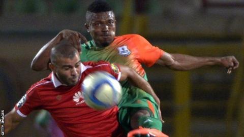 Zesco United defender Adama Ben Bahn (right) in action against Al Ahly