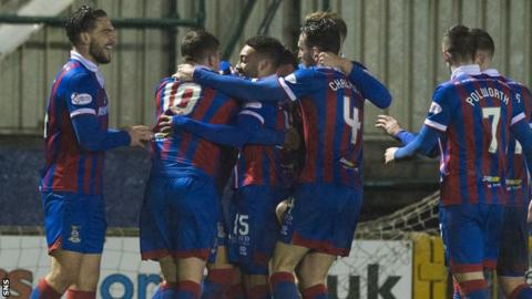 Jake Mulraney is mobbed by Inverness team-mates after scoring