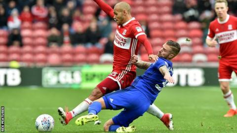 Cardiff City's Joe Bennett tackles Martin Braithwaite