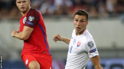 Filip Kiss (right) looks on as England midfielder Eric Dier takes a shot against Slovakia at Euro 2016