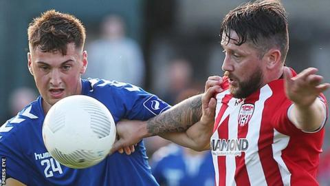 Paudie O'Connor of Limerick competes with Derry striker Rory Patterson at the Brandywell