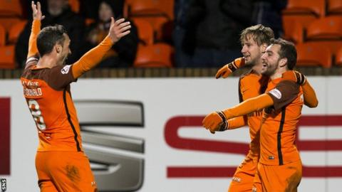 Paul McMullan celebrates after making it 3-0 Dundee Utd.