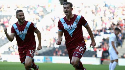 Alex Jones (right) celebrates scoring for Port Vale