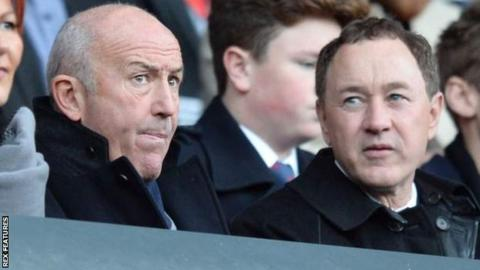 Tony Pulis (left) sits next to Middlesbrough owner Steve Gibson in the stands