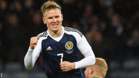 Matt Ritchie celebrates his winning goal for Scotland against Denmark in March