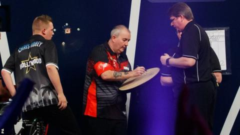 Phil Taylor beats Chris Dobey in first round of World Darts Championship