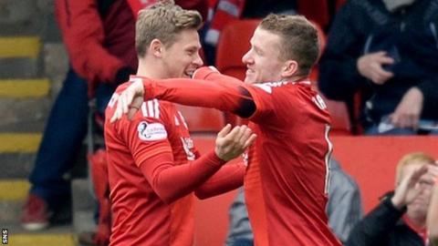 Aberdeen's Simon Church and Jonny Hayes celebrate