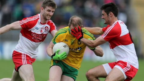 Donegal's Anthony Thompson fails to make headway against a determined Derry defence at St Tiernach's Park