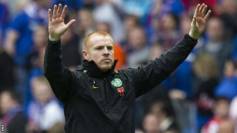 Neil Lennon salutes Celtic fans after a match against Rangers in April 2011