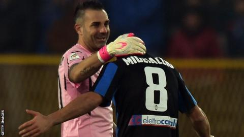 Atalanta midfielder Giulio Migliaccio receives the commiserations of Palermo goalkeeper Stefano Sorrentino after being sent off